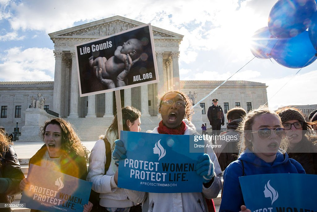 Anti-abortion advocates rally outside of the Supreme Court, March 2, 2016 in Washington, DC. On Wednesday morning, the Supreme Court will hear oral arguments in the Whole Woman's Health v. Hellerstedt case, where the justices will consider a Texas law requiring that clinic doctors have admitting privileges at local hospitals and that clinics upgrade their facilities to standards similar to hospitals.