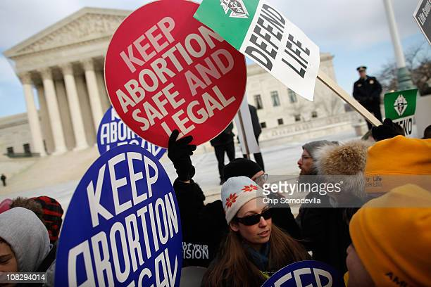 Antiabortion and prochoice demonstrators argue in front of the Supreme Court during the March for Life January 24 2011 in Washington DC The annual...