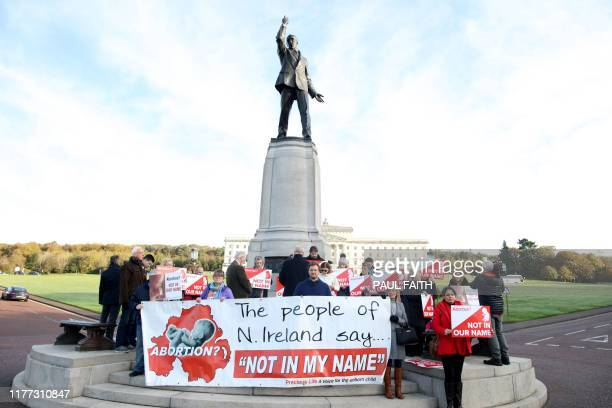 Antiabortion campaigners gather with placards at Parliament buildings on the Stormont Estate in Belfast on October 21 as some of Stormont's assembly...