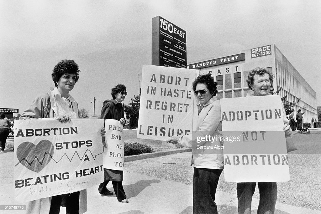 Anti-Abortion Campaigners stage a counter-demonstration during a Pro-Choice march on New York State Route 27 during Reproductive Freedom Week, New York, May 1988.