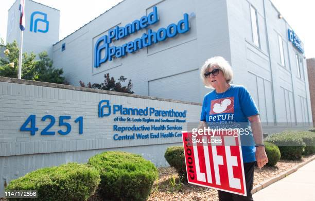 Anti-abortion demonstrators hold a protest outside the Planned Parenthood Reproductive Health Services Center in St. Louis, Missouri, May 31 the last...