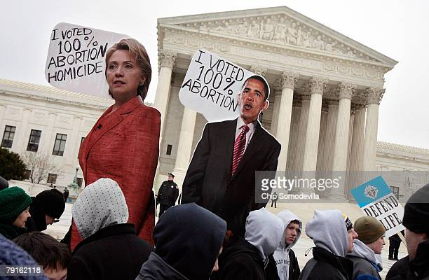 Antiabortion demonstrators hold up images of Democratic presidential hopefuls Sen Hillary Clinton and Sen Barack Obama while participating in the...