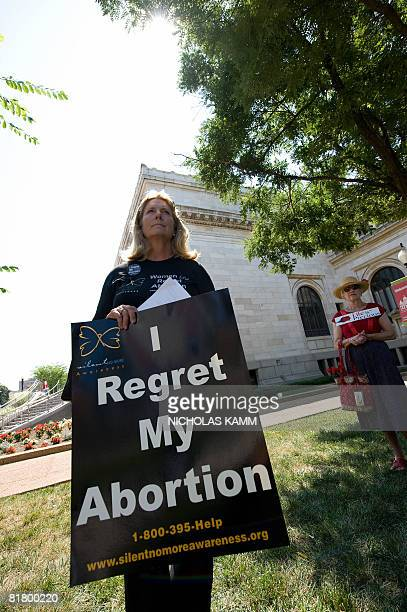 Antiabortion members of the National Education Association demonstrate outside the Washington Convention Center during the association's annual...