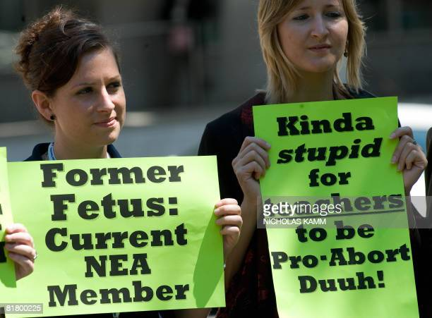 Anti-abortion members of the National Education Association demonstrate outside the Washington Convention Center during the association's annual...