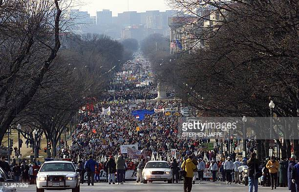Antiabortion protesters march towards the US Supreme Court 22 January 2001 in Washington DC to mark the 28th anniversary of the Court's landmark Roe...