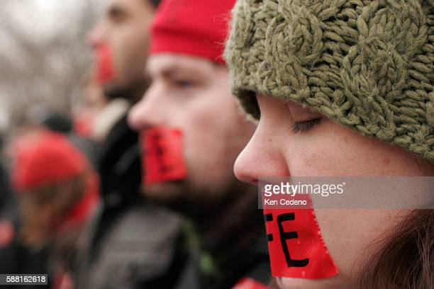 Antiabortion supporters wear red tape across their mouths during the Annual march for Life rally in front of US Supreme Court in Washington DC...