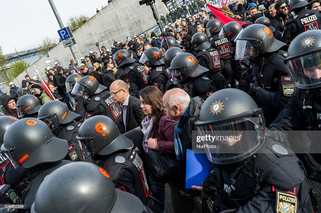 Anti-AFD demonstrators and police forces face near the AfD (Alternative fuer Deutschland) party's federal congress at the Stuttgart Congress Centre ICS on April 30, 2016 in Stuttgart, Germany. The AfD, a relative newcomer to the German political landscape, has emerged from Euro-sceptic conservatism towards a more right-wing leaning appeal based in large part on opposition to Germany's generous refugees and migrants policy. Since winning seats in March elections in three German state parliaments the party has sharpened its tone, calling for a ban on minarets and claiming that Islam does not belong in Germany.
