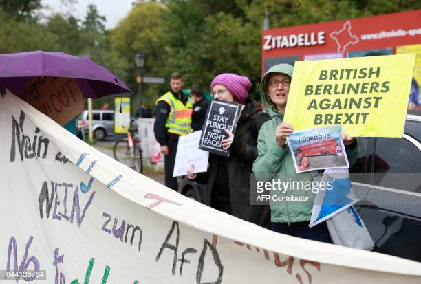 AntiAfD protesters display banners on the sidelines of a visit by British politician Nigel Farage former leader of the UK Independance Party at an...