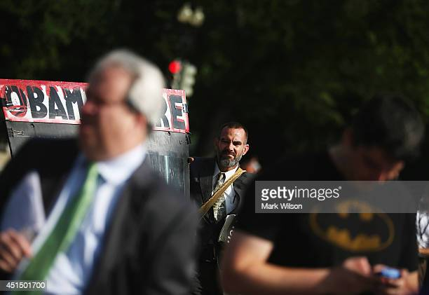 AntiAffordable Care Act proster Alan Hoyle stands in front of the US Supreme Court June 30 2014 in Washington DC The high court is expected to hand...