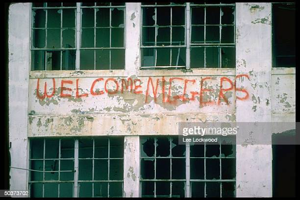 AntiAfrican American writing on South Boston building during school busing integration reading WELCOME NIGGERS