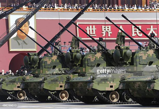 Anti-aircraft artillery is driven past Tiananmen Gate during a military parade in Beijing on September 3 to mark the 70th anniversary of victory over...