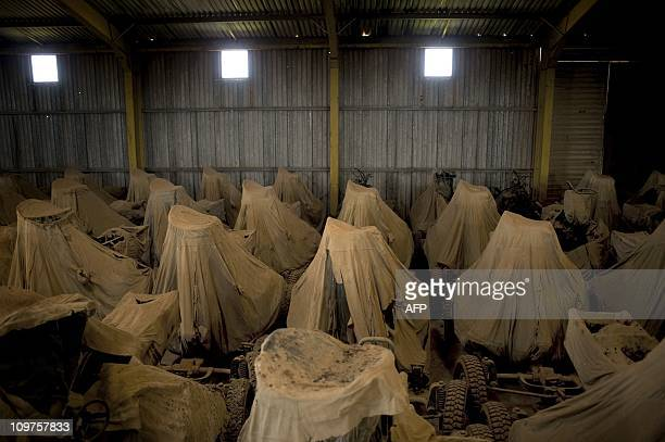 Antiaircraft guns and other military hardware are stocked in a warehouse controled by the opposition force army outside Benghazi on March 01 2011 as...