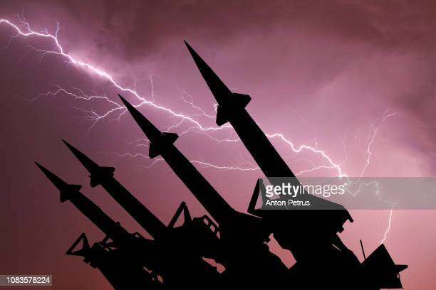anti-aircraft missile system are directed upwards against the background of thunderstorm - ミサイル ストックフォトと画像