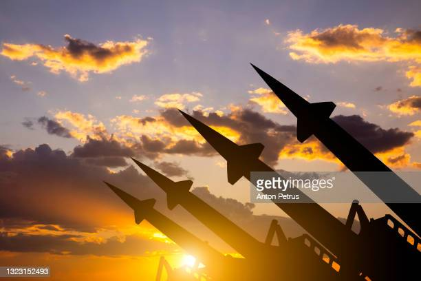 anti-aircraft missile system on the background of sunset sky - war and conflict stock pictures, royalty-free photos & images