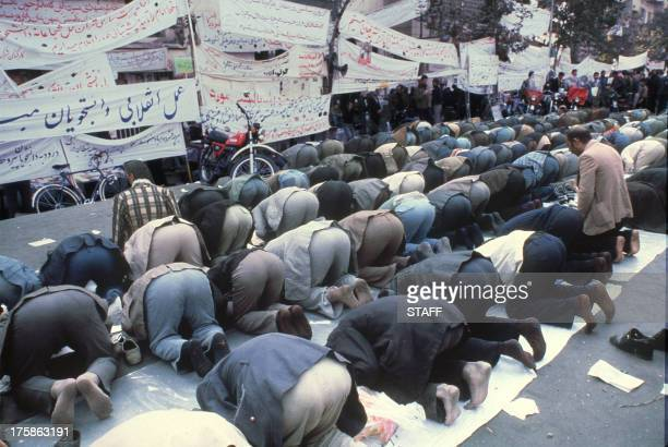 Anti-American Iranians pray outside of the U.S. Embassy, 20 November 1979. The fanatical followers of the Ayatollah Khomeini stormed the United...