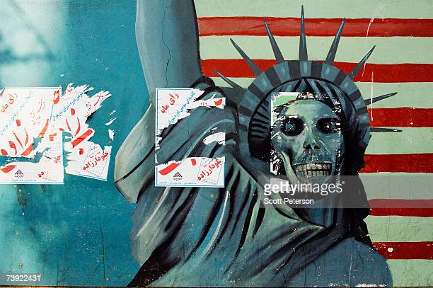 Anti-American murals showing guns and a Statue of Liberty with a skull for a face adorn the former U.S. Embassy on December 16, 2006 in downtown...