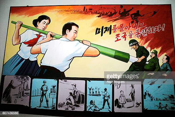 AntiAmerican poster at No 1 school in Moranbong showing students stabbing an American soldier with a pen holder