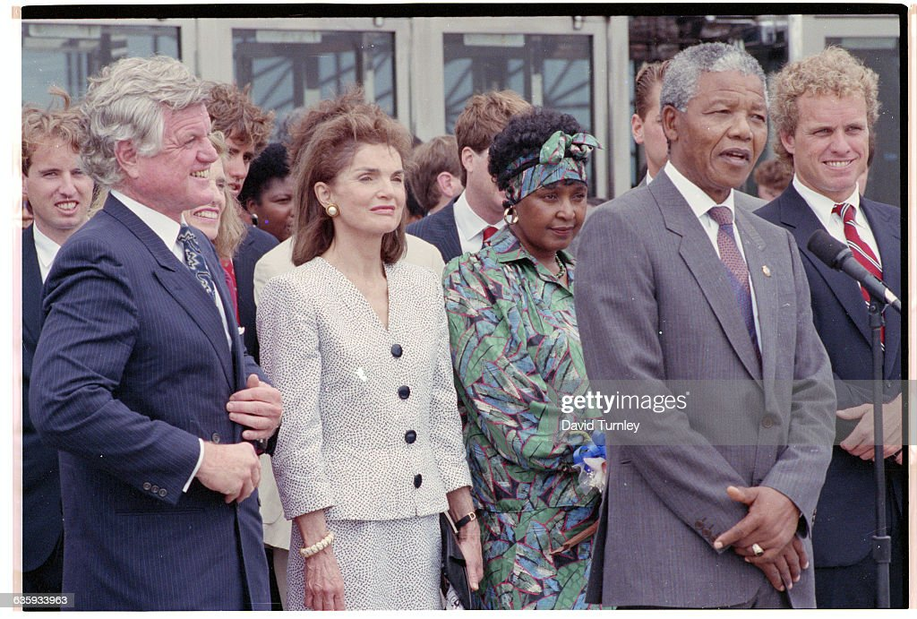 Anti-apartheid activist Nelson Mandela meets with members of the Kennedy family in Boston during a 1990 tour of the United States following his release from a South African prison. In front, from left to right, are Senator Ted Kennedy, Jacqueline Kennedy Onassis, Winnie Mandela, Nelson Mandela, and Congressman Joe Kennedy.