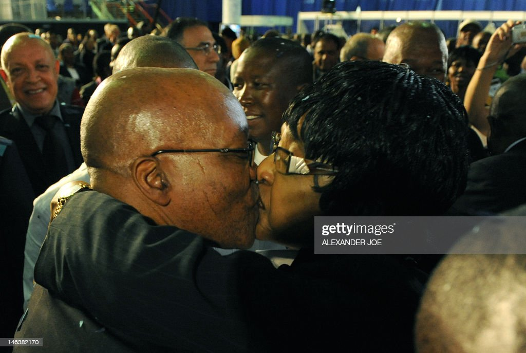 Anti-apartheid campaigner anti-apartheid campaigner Winnie Mandela (R) congratulates South Africa's president-in-waiting Jacob Zuma (L) in Pretoria on April 25, 2009. Zuma's ruling The African National Congress (ANC) won an absolute majority in the countires general election. South Africa's ruling ANC swept general elections with just short of two-thirds of the vote, the final count showed, putting party leader Jacob Zuma at the doorstep to the presidency. AFP PHOTO / ALEXANDER JOE / AFP PHOTO / Alexander JOE