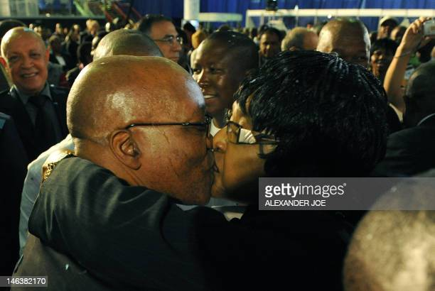 Antiapartheid campaigner antiapartheid campaigner Winnie Mandela congratulates South Africa's presidentinwaiting Jacob Zuma in Pretoria on April 25...