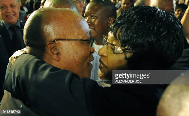 Antiapartheid campaigner Winnie Mandela congratulates South Africa's presidentinwaiting Jacob Zuma in Pretoria on April 25 2009 Zuma's ruling The...