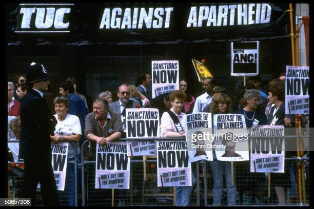 AntiApartheid demonstrators holding vigil for commonwealth decision in favor of economic sanctions toward South Africa