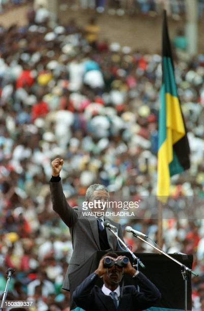 Antiapartheid leader and African National Congress member Nelson Mandela adresses a rally attended by over 100 000 people at Soccer City Stadium in...