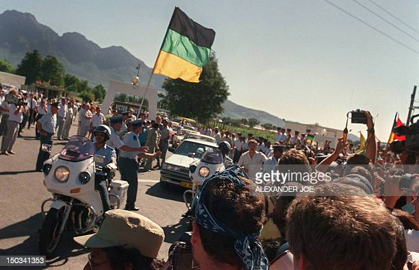Anti-apartheid leader and African National Congress member Nelson Mandela rides in car through cheering fans as exiting from Victor Verster prison...