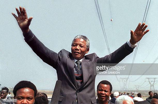 Antiapartheid leader and African National Congress member Nelson Mandela salutes supporters while addressing on September 05 1990 in Tokoza a crowd...
