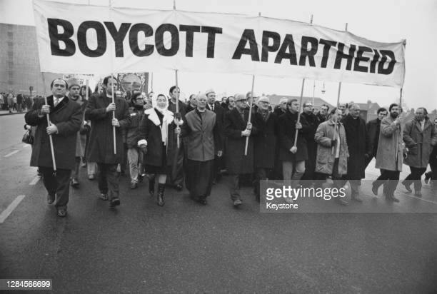 Anti-apartheid marchers carrying a banner reading 'Boycott Apartheid' marching to Twickenham rugby ground where England are playing South Africa, in...