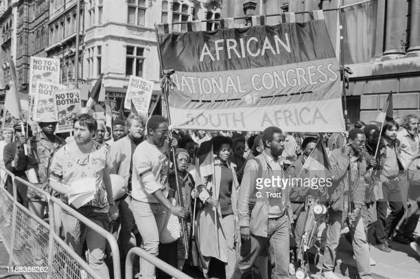 Anti-Apartheid Movement's 'No to Botha' demonstration marching in London while British Prime Minister Margaret Thatcher was meeting South African...
