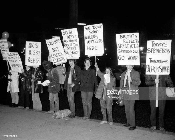 AntiApartheid protestors with placards outside the South African Embassy in Trafalgar Square London where the South African Ambassador Dr Hendrik G...