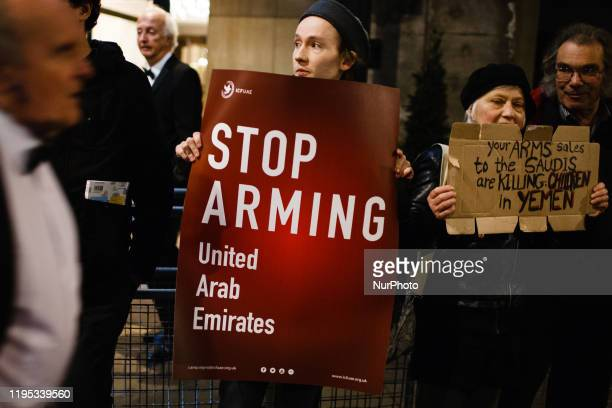 Antiarms trade activists demonstrate as attendees arrive for the annual blacktie dinner of the Aerospace Defence and Security Group at the Grosvenor...