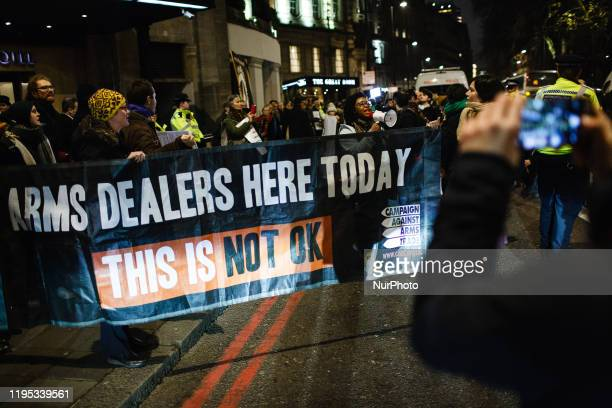 Antiarms trade activists demonstrate outside the annual blacktie dinner of the Aerospace Defence and Security Group at the Grosvenor House Hotel on...