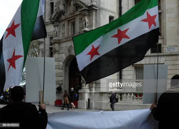 AntiAssad protestors hold a demonstration outside The National Liberal club in London where members of the Assad regime are giving a speech on April...