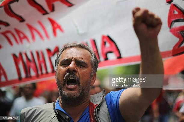 Antiausterity demonstrators from the communist party take part in a minor rally through the streets of Athens on July 11 2015 in Athens Greece Greek...