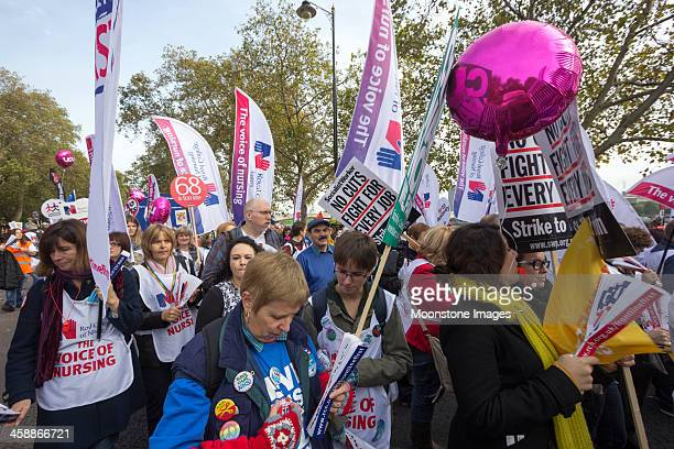 anti-austerity march in london, england - nursing slogans stock photos and pictures