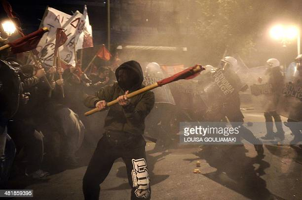 Antiausterity protesters clash with police blocking their way towards the venue of the European Union Informal Meeting of Ministers for Economic and...