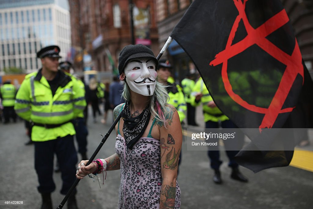 Anti-austerity protesters gather outside Manchester Central during on the second day of the Conservative party conference on October 5, 2015 in Manchester, England. The second day of the 2015 autumn conference is being dominated by the economy and the appointment of Labour peer Lord Adonis as head of the National Infrastructure Division (NIC) which will will advise the Government on road, rail, housing and energy projects.