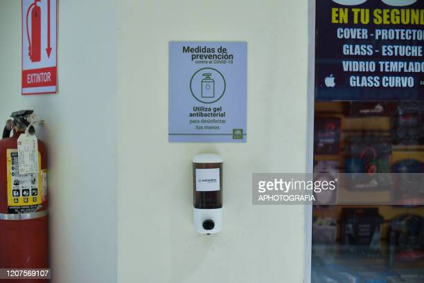 Antibacterial gel is placed inside of a mall for customers to sanitize their hands on March 17 2020 in San Salvador El Salvador Despite no cases of...