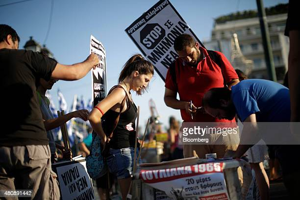 Antibailout protestors prepare banners outside the Greek parliament during a demonstration in central Athens Greece on Wednesday July 15 2015 Greek...