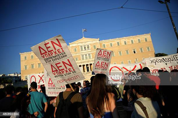 Antibailout protestors wave banners outside the Greek parliament during a demonstration in central Athens Greece on Wednesday July 15 2015 Greek...