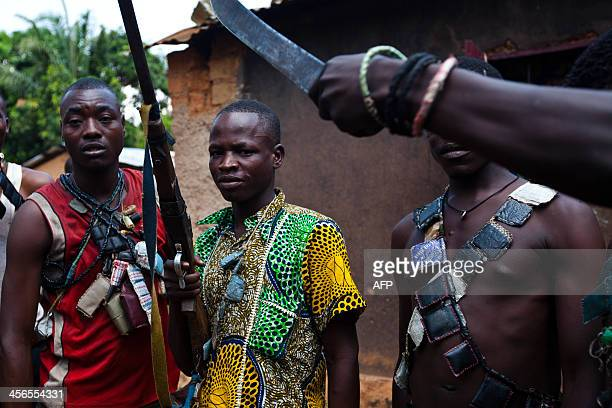 AntiBalaka fighters members of a militia opposed to the Seleka rebel group show their weapons and amulets in a village in the BoyRabe neighborhood in...