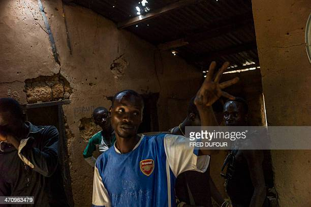 Antibalaka fighters stand in a house where they clashed with Chadians soldiers a few days ago in Damara Central African Republic on February 21 2014...