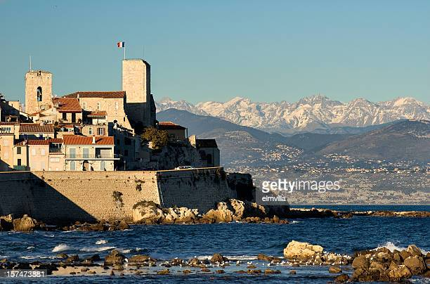 antibes citadel and the alps - antibes stock photos and pictures