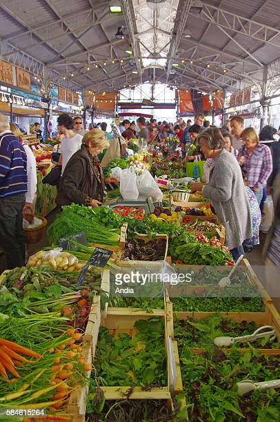 the covered market in the old town close to the harbour here a vegetable stall