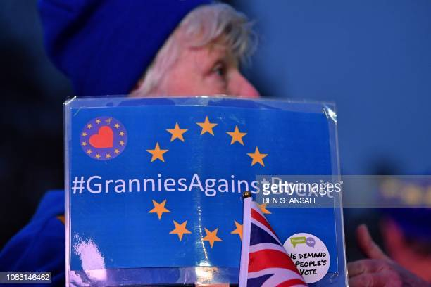 AntiBrexit activist holds a placard reading Grannies Against Brexit as she demonstrates with other protesters outside of the Houses of Parliament in...