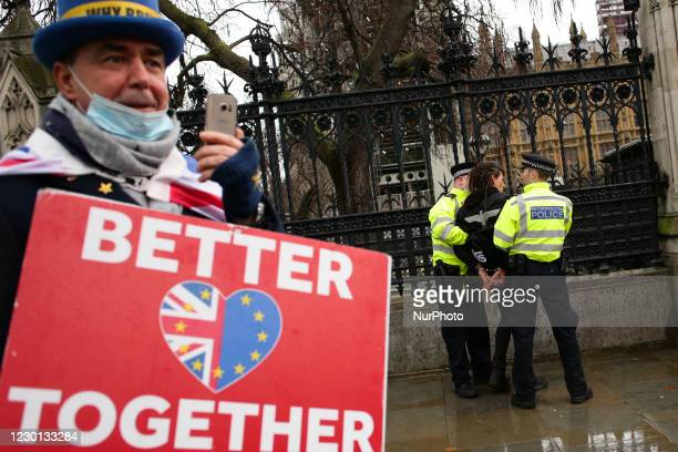 Anti-Brexit activist Steve Bray watches as an activist protesting against coronavirus lockdown restrictions and any mandated covid-19 vaccinations is...