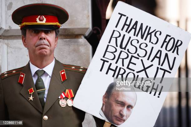 Anti-Brexit activist Steve Bray, wearing a military uniform of the former Soviet Union, demonstrates with a placard of Russian President Vladimir...