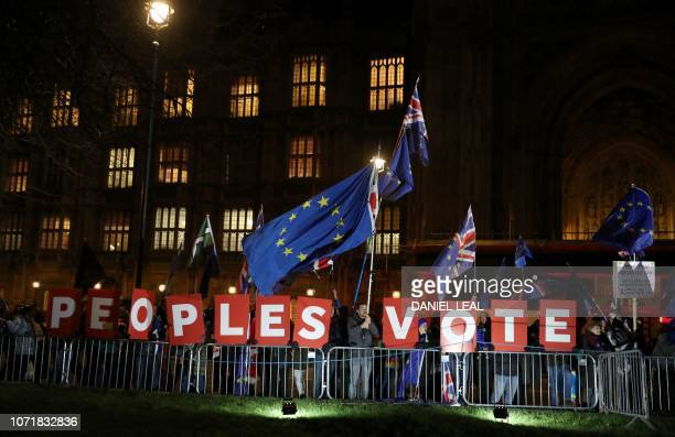 AntiBrexit activists calling for a 'People's Vote' on the Brexit deal protest outside the Houses of Parliament in London on December 11 2018 British...